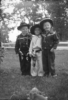 Three young cowboys....love the little puppy as their admirer.