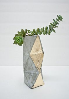 Proof that concrete can indeed be beautiful.  Succulent planter, $75, by Concrete Geometric.
