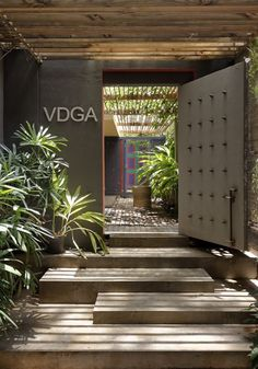 VDGA OFFICE - Picture galleryVDGA OFFICE - Picture galleryGrand Designs explores homes with great ambitions in a small spaceThe double-height entrance hall creates a breathtaking view when the light hits the wooden slats on the Entrance Design, House Entrance, Gate Design, Entrance Doors, Door Design, House Design, Office Entrance, Modern Entrance, Entrance Ideas