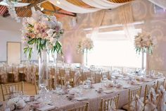 Blush and gold wedding flowers created by Akiko Floral Artistry.  Photo Credit:  Milton Photography.  #phalaenopsis #orchids #blush #gold #blushandgold #ivory #tulips #roses #peonies #hydrangea #ceiling #draping