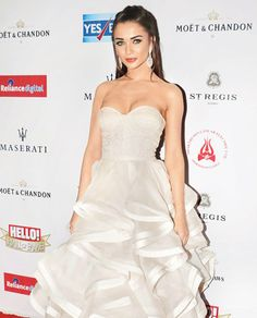 Someone as attractive as Amy Jackson would've done well in a design that probably flattered her silhouette a bit more. Instead they put her in a gown with frills and styling appropriate for a bride. Amy Jakson, Strapless Dress Formal, Formal Dresses, Moet Chandon, Over The Top, Asian Beauty, Red Carpet, Bollywood, Jackson