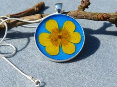 Buttercup in Blue/ Real Flower in Resin Necklace from AstroScent by DaWanda.com