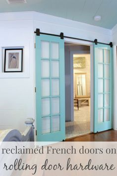 Add some color to your space with blue french doors, hung on rolling hardware.