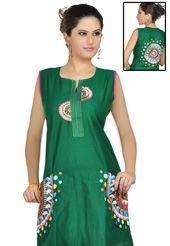 I love this tunic- easy to wear with anything and the work done is gorgeous!! (This deep green cotton readymade tunic is nicely designed with resham, applique and patch work done in form of geometric motif. Beautiful embroidery is enhancing the beauty of this tunic.)