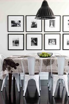 Monochrome dining room with gallery wall.