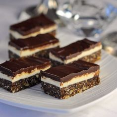 ROCK RECIPES - These delectable, no-bake Chocolate Mint Nanaimo Bars are a twist on a classic Canadian treat that originated in its namesake town in British Columbia. Nanaimo Bars, Köstliche Desserts, Delicious Desserts, Yummy Food, Romanian Desserts, Rock Recipes, Easy Recipes, Icecream Bar, No Bake Cookies