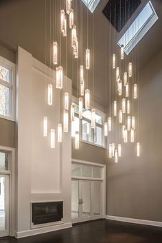 Modern stained glass chandelier for foyer or entryway. ShimalePeleg #contemporarylighting #modernlighting #foyerchandelier #handblownglass #staircaselighting #ceilinglight #chandelierlighting