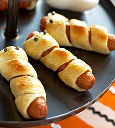 The kids loved these!   Fill up hungry tummies with this loveable finger food. Wrap refrigerated breadstick dough around jumbo frankfurters, letting the frankfurters show slightly through the bread. Press in capers for eyes. Bake in a preheated 375-degree oven for about 12 minutes or until bread is golden.