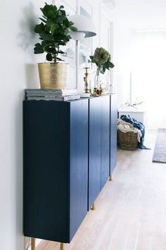 Inventive Ways to Use IKEA's IVAR All Over the House Inventive Ways to Use IKEA's IVAR All Over the House Adding legs, then painting it blue, turns IVAR cabinets into a dining room credenza that looks chic and functional in Caterina's home. Ikea Ivar Cabinet, Ikea Cabinets, Credenza Ikea, Credenza Decor, Shoe Cabinet, Kitchen Cabinets, Ivar Ikea Hack, Ikea Hacks, Kallax Hack