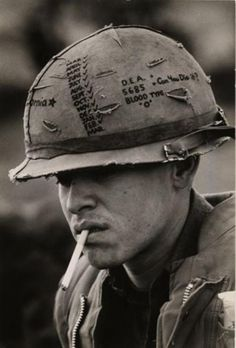 "historicaltimes: "" ""Battle fatigue set in long ago for most the men … Lance Cpl. Ernest Delgado … is from Los Angeles and has been checking the months off on his helmet. "", Battle of Khe Sanh, South Vietnam by David Douglas Duncan. Keep reading """