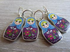 A set of 4 russian doll enamel stitch markers. To be used with knitting needles up to 6.00 mm/US 10.