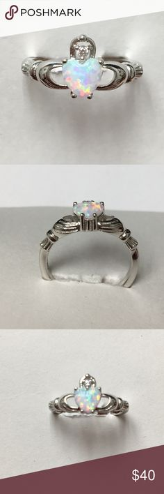 Sterling Silver Claddagh white lab Opal Ring Beautifully colorful white lab opal stone. Even more breath taking in person. Perfect for a Promise ring, or just to show someone you care. Size 6 Available. End of stock. Will be available to ship weekend of the 12th. Jewelry Rings