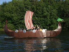 Pontoon boat turned into a Viking Ship. Paper mache dragon on the front. Cardboard Box Boats, Viking Yachts, Boat Parade, Parade Floats, Viking Party, Party Barge, Sand Lake, Poker Run, Pirate Decor