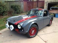 '64 Triumph TR4 ... w/ 4-speed overdrive and two-piece Surrey top.