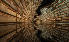 Shanghai-based architecture and design studio XL-Muse designed the interior of the Yangzhou Zhongshuge bookshop in China to look like a mirrored, curved water passage. Yangzhou, Glass Floor, Floor Mirror, Mirror Glass, Full Mirror, Mirror Maze, Mirrors, Library Architecture, Modern Architecture