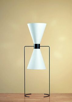 This floor lamp was designed in 1940 by the legendary designer Isamu Noguchi. Isamu Noguchi was one of America's most influential architects, furniture designers and artists of the 20th century. Born