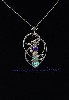 This Sterling Silver wire wrapped pendant was created using a purple colored Cubic Zirconia (CZ) set in a Sterling Silver snap setting and an Aurora Borealis coated crystal, faceted, bead. Silver Jewelry Cleaner, Metal Jewelry, Sterling Silver Jewelry, Gold Jewelry, Diamond Jewelry, Jewelry Rings, Jewellery Box, Jewelry Shop, Jewelry Ideas