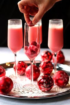 Raspberry Cream Mimosa -- thinking of adding in cranberries to this recipe to make this cocktail extra festive for the holidays!