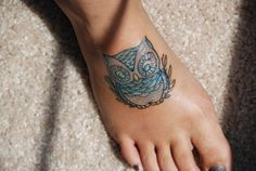 Cute little owl tattoo