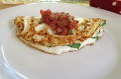Spinach and cheddar egg white omelet with salsa and other omelet ideas. This is so similar to what I eat most mornings, but there are some good ideas here for other omelets!