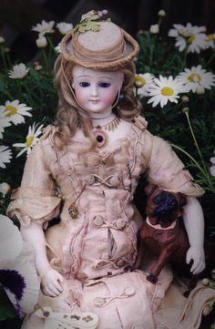 Dolls from Antoine Rochard are extremely difficult to come by. The Grovian Doll Museum possesses two models including the ingénue shown here. Originally retailed at the prestigious Maison Simonne on Paris' famed boulevard, Rue de Rivoli, this petite example has a single Stanhope mounted in her shoulderplate, representing the drop in an intricate necklace. When one looks through the Stanhope, the reward is a black and white view of Jesus holding the hand of a child.