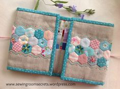 Needlebook - with spaces for paper needlebooks, could add some felt pages for loose needles! http://sewingroomsecrets.wordpress.com/2013/08/12/little-hexie-needle-caddy/