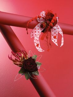 Red spray roses wrist corsage with various ribbons (upper right) and single red roses with nerine and wires (bottom left)