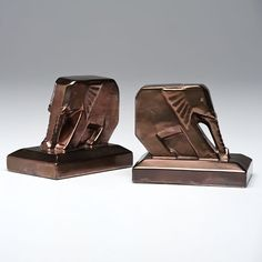 Cowan Pottery Elephant Bookends. They are Push These lines are so lovely and the color of the glaze just mesmerizes me in the morning.