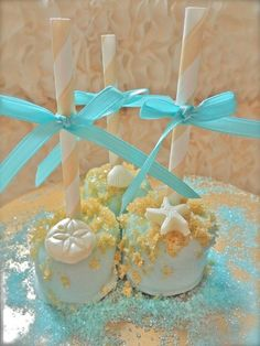 Marshmallow pops wedding favors but white and gold with navy blue ribbons