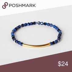 Gold Bar and Lapis Blue Beaded Bracelet Deep lapis blue and gold filled beads flank a gold filled bar. The blue beads are fire polished and have varying shades of blue and black swirled around one another. Wear it alone or layer it with other bracelets. This bracelet is from an online boutique I run which no longer sells this piece. It's handmade by an artisan called Junghwa by Amy Stewart. This was selling for $31. bracelets are brand new but are all slightly unique because of handmade…