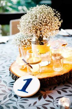 Navy, dove grey and ivory were the colours used for the engagement party and wedding. Photos by Inlighten Photography.