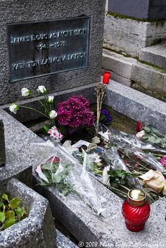 "05/15/2008 Père Lachaise Cemetery Paris France  This is the grave of the American singer, Jim Morrison. The engraving, ΚΑΤΑ ΤΟΝ ΔΑΙΜΟΝΑ ΕΑΥΤΟΥ means ""According to his own spirit"" (""daimon"" means a guiding spirit, like an angel on one's shoulder), and is interpreted to mean ""true to his self"".   Père Lachaise Cemetery located in the 20th arrondissement, The cemetery was established by Napoleon I in 1804. Cemeteries had been banned inside Paris in 1786, after the closure of the Saints…"