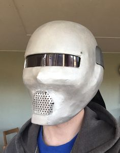 Papier mache mask made of a skateboardhelmet with a framework of steel wire