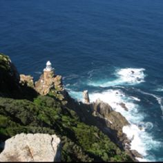 Cape Point and it's lighthouse - Cape Town. Where the Atlantic and Indian Oceans meet. Also known as the Cape of Storms due to the stormy weather conditions.