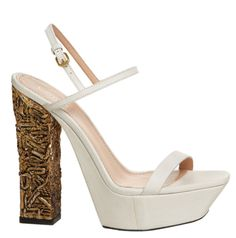 Calvin Klein's spring 2013 line includes a lot of accessories. A very unique style that Klein incorporates into his 2013 collection include wood carving. Certain pairs of his heals have heals made from wood decorated with detailed designs. Chelsea M.
