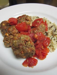 Greek Turkey Meatballs with Spinach Pesto & Feta    1 lb.lean ground turkey  1/2 c. rolled oats  1 c. Italian-style breadcrumbs  1/2 c. spinach pesto (followed this recipe, but substituted walnuts)  1/4 c. grated Parmesan cheese  1/3 c. feta cheese, crumbled  1 egg  1/4 tsp. ground black pepper  1/8 tsp. salt  14.5 ounce can diced tomatoes, UNdrained