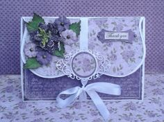 #cheeryld Something to share.. something totally different then a card or 8x8 layout. I've created a envelope to put a gift in to thank someone dear to me. Dies used:  DL187 - Kaleidoscope Lace Mega Doily; B324 - Poinsettia Strip; B424 - Sentiment Tag 1 (set of 3); B241 - Rose Leaf Strip; B189 - Sentiment Frame # 1; B136 - Anastasia Border; B152 - Miniature Rose http://www.cheerylynndesigns.com
