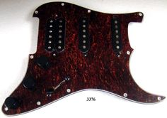 THIS IS A FULLY LOADED, WIRED, AND READY TO INSTALL HUM / SINGLE / SINGLE TORTOISE SHELL PICKGUARD FOR FENDER STRAT. THE PICKUPS ARE AMERICAN STANDARD BRIDGE HUMBUCKER AND TWO SINGLE COIL.Loaded Pickguard #3376.The wiring includes one volume and two tone controls, high quality 250K pots, and 5 way switch.We include a Push/Pull Switch in the middle knob position which links together the Bridge and Neck Pickups. This makes the following pickup selections possible:Bridge onlyBridge and Middle…