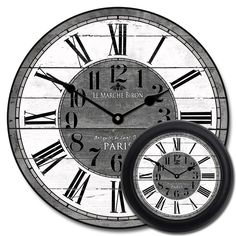This clock has gray tones with black accents and a white face. It is charming with subtle large cracks in the face. It works well with many shades of gray. It comes in seven sizes so you can choose the one that works best in your room.    Materials/Ship TimeWeight