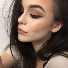 neutral matte dark eye and soar mac liner filled in lip, bold and thick brows
