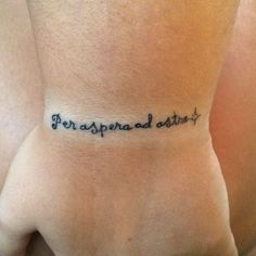 "Little wrist tattoo saying ""Per aspera ad astra"" in Latin, which means ""A rough road leads to the stars"". Tattoo sent by a Little Tattoos fan."
