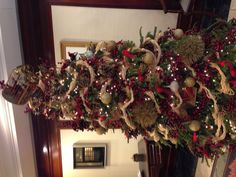 Tree with raffia garland and red berries