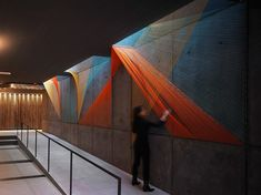 "This playful rope #installation, called ""Prism"" adds multifaceted color to a gray, concrete space. #art #architecture"