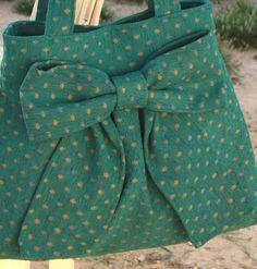 Polka dot bow purse.