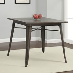 Classic industrial style blends with chic vintage-inspired finishes to give your a gorgeous four-seat dining table to complement your contemporary home. The sturdy metal frame is finished in a lasting powder coat while the top sports an antiqued look.