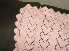 A lovely lace baby blanket with a heart motif, knit in Berroco Comfort by the Spicy Knitter {pattern by Regina Fulton}