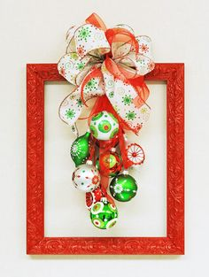 Ben Franklin Crafts and Frame Shop: D. Christmas Frame Wreath loving the big… Ben Franklin Crafts and Frame Shop: D. Christmas Frame Wreath loving the big swaggy look, perhaps a summer theme with flip flops and big plastic glasses Diy Christmas Urns, Cheap Christmas Crafts, Christmas Fun, Holiday Crafts, Christmas Colors, Christmas Ornaments, Picture Frame Wreath, Christmas Picture Frames, Picture Frame Crafts