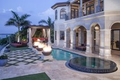 Mediterranean Patio At Dusk Features Infinity Spa, Luxurious Pool, Warming Fire Bowls & Enchanting Lounge | HGTV