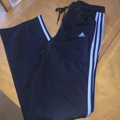 Adidas work out pants Black with blue stripe. Size small. Good condition! Adidas Pants