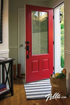 Bold front doors create a welcoming entrance. We love a vibrant red door.